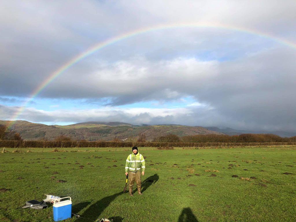 Collecting plant samples on Dyfi Estuary